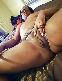 Cute ebony prostitute playing with his big stiff pecker